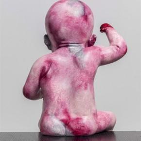 Zhang Xiaogang, Baby No. 2, 2013; painted bronze, 41.6x23.5x18.4cm