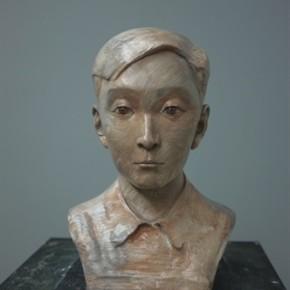 Zhang Xiaogang, Young Boy No.1, 2013; painted bronze, 55.9x27.9x33cm