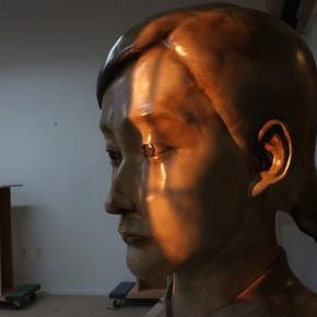 Zhang Xiaogang, Young Woman, 2013; painted bronze, 112x62x56cm