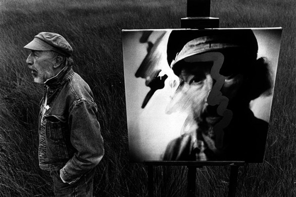 Hamilton in a field near his Henley home with a painting from his 1992 Tate show; Photograph John Reardon/The Guardian