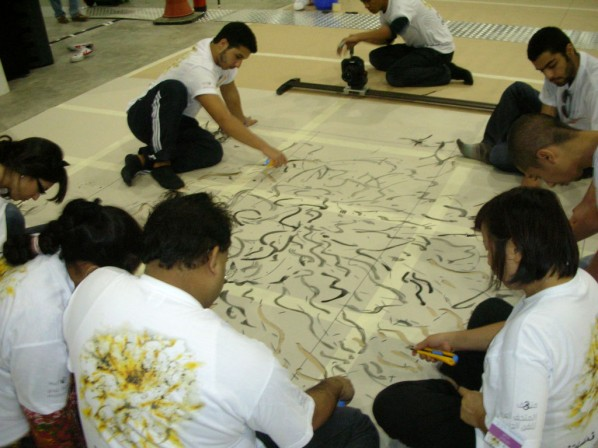 Here are some volunteers making his painting into a stencil.