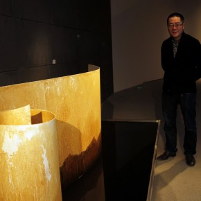 Work 011 Curator Wang Huangsheng stood behind his work.