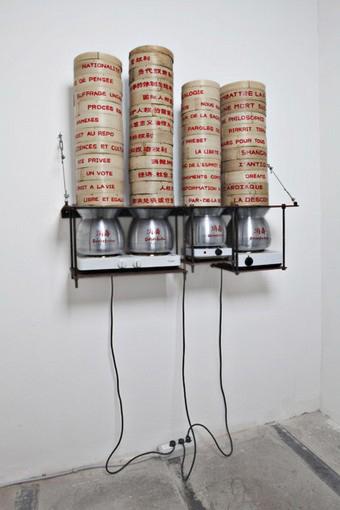 Chen Zhen-La Désinfection, 1997; hot plates, aluminum pots, steam bamboo ovens, books, iron, H 100×120×X42cm