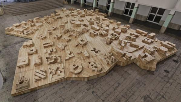 "Ai Weiwei, ""Ordos 100 Models"", 2011; pine wood, video, 80x1511x1357.3cm ©Ai Weiwei Courtesy Galleria Continua"