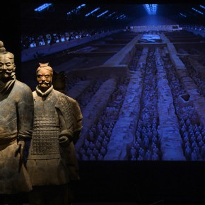 "04 Two Terracotta Warriors stand guard by a projected photograph showing the original excavation site 02 290x290 - Asian Art Museum celebrates its 10th anniversary with exhibition ""China's Terracotta Warriors: The First Emperor's Legacy"""