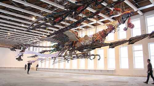 The internally illuminated 12-ton birds are suspended mid-air inside the museum's football field-sized Building 5