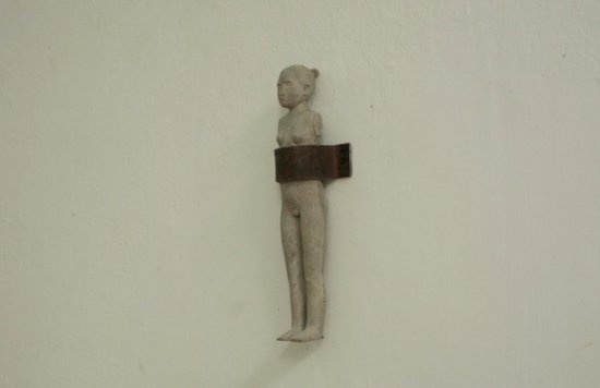 Tiny Figure, 2013, Cement and iron, 7 x 35 cm; Courtesy of Yu Ji and Osage Gallery