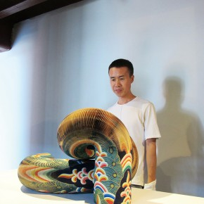 "Li Hongbo with His Work 290x290 - Group Exhibition of ""Jiang Qi 3"" on View at Red Gate Gallery"