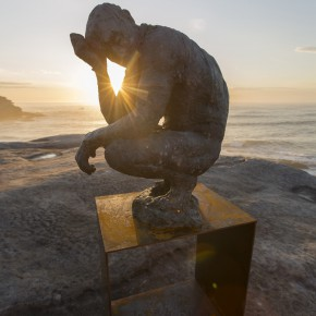 Laurence Edwards, crouching man, Sculpture by the Sea, Bondi 2015. Photo Gareth Carr