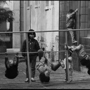 Pan Ke, Children Play with the Bicycle Parking Facilities on Street, Xi'an, 1988