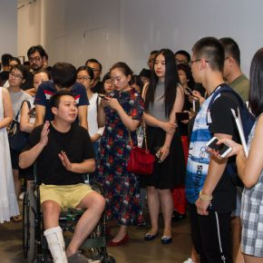"07 Curator Cui Cancan guided the media in visiting the exhibition 290x290 - Origin, Surge and Echo: ""A CHANG"" – the Solo Exhibition of He Yunchang, presenting Two Decades of Persistence"