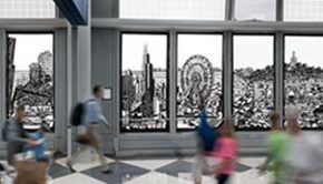 "18 Passengers walking hastily in front of the paper-cut installation ""Windows of the City"" at the O'Hare International Airport, 2800 x 300 cm, 2014"
