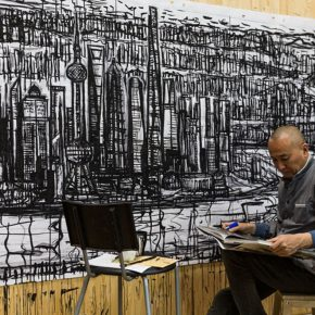 "32 Qiao Xiaoguang was drawing the draft of the ""Window of Shanghai"" at his studio, photo courtesy of Liu Yun, 2015"