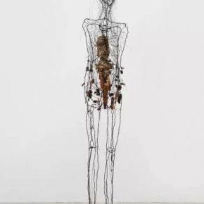 07 Fu Xiaotong, Mother, 2017; Installation, iron, wood, linen, newspaper and soil, 190x33x30cm