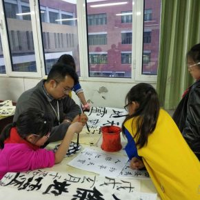 Artist Huang Wei from T3 Artistic Community was giving a calligraphy lesson to students