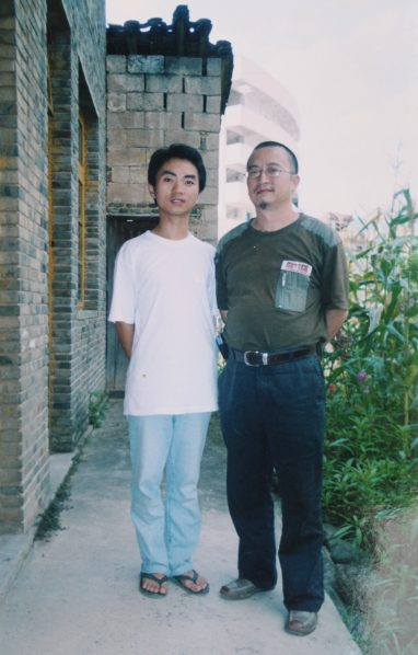 "11 Group Photo of Ran Jinsong and Xu Feng 2005 382x598 - Xu Feng—To Embrace the World While Wearing the Mask of a ""Rabbit"""