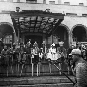 5.In 1949, the Stilts Team resting in front of the railway hotel in Shenyang. 46.2×45.4cm