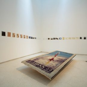 Joana Hadjithomas & Khalil Joreige, A Carpet...2012; Woven rug, forty printed archival documents and three screens