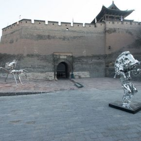 Two silver sculptures with modern features at the entrance