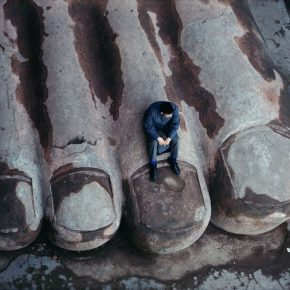 Bruno Barbey, Sitting on the Toe of Giant Stone Buddha at Leshan Mountain; Photography, 1980, 100×150cm